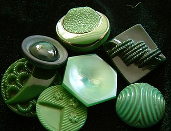 Mostly art deco buttons in that green so much ...