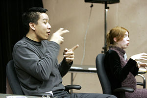 pictures of 2 sign language interpreters worki...