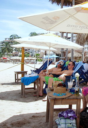 English: Gay Beach and hotel Blue Chairs in Pu...