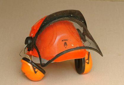 Ear defenders and visor on a safety helmet
