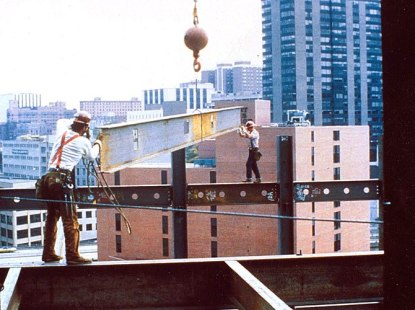 Construction workers at a considerable height ...