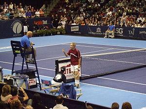 John McEnroe, arguing with umpire. Champions C...
