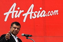 {{w|Tony Fernandes}} at Airasia fair