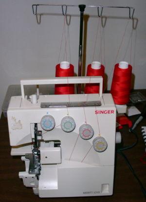 Singer 14U344B overlock sewing machine set for...