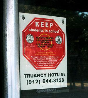 Truancy hotline road sign.