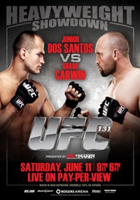 A poster or logo for UFC 131: Dos Santos vs. Carwin.