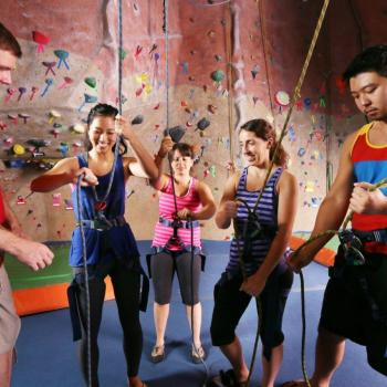 belay intro class with rock climbers learning to belay at upper limits downtown st. louis best indoor rock climbing gym