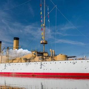 USS Olympia in Port
