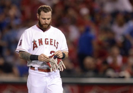 Oct 3, 2014; Anaheim, CA, USA; Los Angeles Angels left fielder Josh Hamilton (32) reacts after grounding into a double play against the Kansas City Royals in the 10th inning in game two of the 2014 ALDS playoff baseball game at Angel Stadium of Anaheim. Mandatory Credit: Robert Hanashiro-USA TODAY Sports