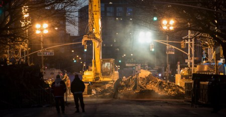Crews continued to work into the night near the site of the explosion, where two bodies were found. (PHOTO CREDIT: Andrew Renneisen for The New York Times)