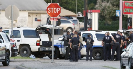 Police block the intersection of Dowdy Ferry Rd. and Interstate 45 during a standoff with a gunman barricaded inside a van in Hutchins, Texas. (Brandon Wade/AP)