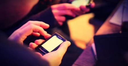 A Pew Research study said less than 10 percent of young people are OK with using cellphones at church. (Flickr photo by Phil Campbell)