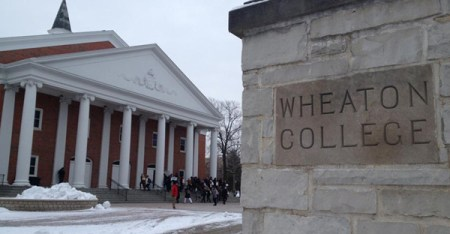 """Students chant """"Reinstate Doc Hawk,"""" as the bell rings for the first chapel of spring semester at Wheaton College. (Religion News Service photo by Emily Miller)"""