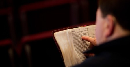 A parishioner reads the bible before a service at the Christian Fellowship Church in Benton, Ky. (David Goldman/The Associated Press)