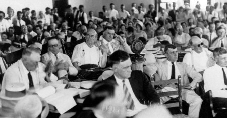 This July 15, 1925 file photo shows attorney William Jennings Bryan, sitting center behind the microphone during a radio broadcast of the landmark trial of John Thomas Scopes in Dayton, Tenn. The controversial trial between religion and state determined how evolution would be taught in schools.  Scopes, a high school biology teacher,  was found guilty of teaching evolution and fined.  The town hosts an annual festival, this year July 20-21, marking the anniversary of the famous trial about the teaching of evolution in public schools.  (AP Photo, file)
