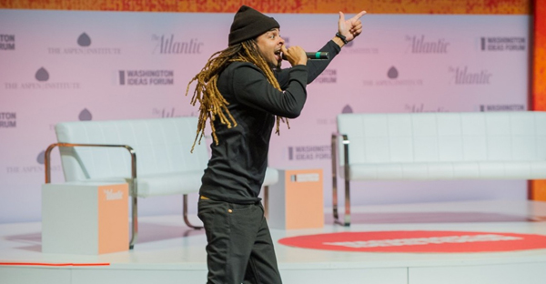 "Rapper Dee-1 performs ""Sallie Mae Back"" at Washington Ideas Forum, where he also spoke about his financial literacy campaign with PricewaterhouseCoopers. (Courtesy of Max Taylor Photography)"