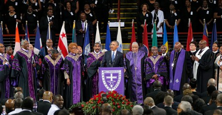 """U.S. President Barack Obama leads mourners in singing the song """"Amazing Grace"""" as he delivers a eulogy in honor of the Rev. Clementa Pinckney during funeral services for Pinckney in Charleston, S.C., on June 26, 2015. Pinckney is one of nine victims of a mass shooting at the Emanuel African Methodist Episcopal Church. (Photo courtesy of Reuters/Brian Snyder)"""