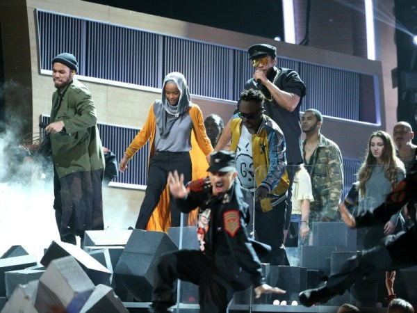 A Tribe Called Quest and Anderson Paak break down a wall during their performance at the 59th Annual Grammy Awards Feb. 12, 2017, in Los Angeles, Calif. (Photo by Lucy Nicholson/REUTERS)