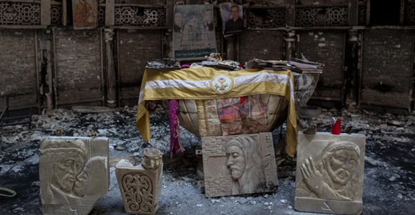 Salvaged books and other items are placed around the altar of a church, burned and destroyed by ISIS during the group's occupation of the predominantly Christian town of Qaraqosh, Iraq, on Dec. 27, 2016. (Chris McGrath—Getty Images)
