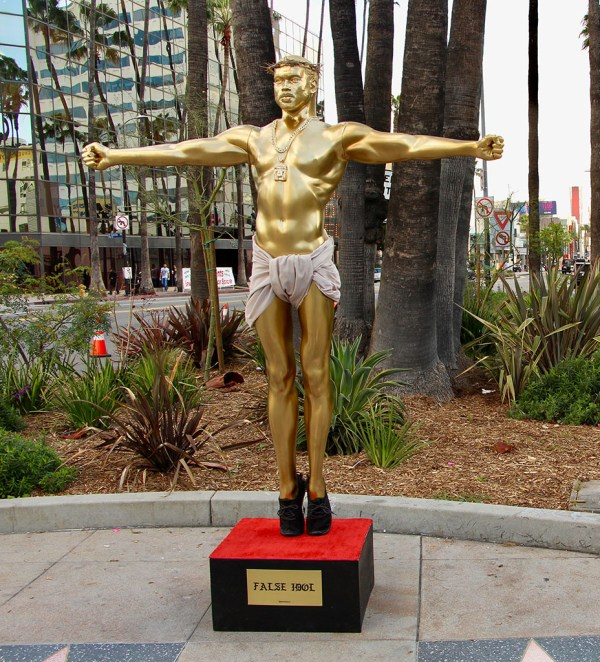An image of Plastic Jesus' new work, a life-size sculpture that casts Kanye West as a crucified Jesus. It was installed on Hollywood Boulevard on Feb. 22. (Photo: Jordan Riefe)