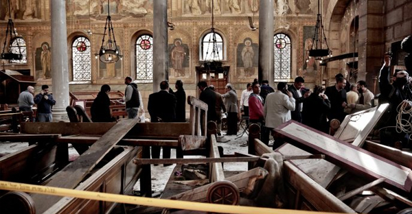 In this Dec. 11, 2016 file photo, security forces examine the scene inside the St. Mark Cathedral in central Cairo, following a bombing that killed dozens of people. (Credit: AP Photo/Nariman El-Mofty, File)