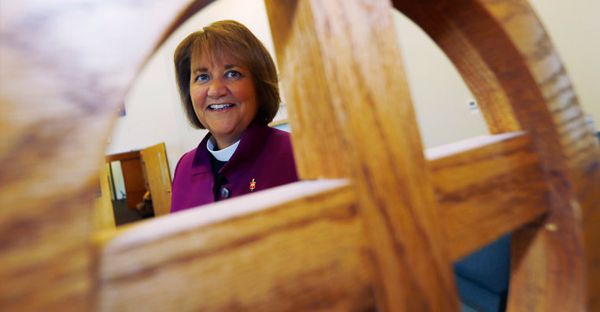 """Bishop Karen Oliveto this month in a chapel in Highlands Ranch, Colo. A court ruled that she """"remains in good standing"""" pending further proceedings. (Credit: David Zalubowski/Associated Press)"""