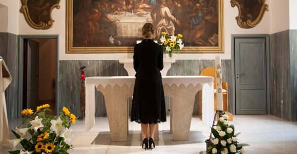 First lady Melania Trump prays at the chapel of the Vatican-owned Bambino Gesù pediatric hospital in Rome on May 24. (L'Osservatore Romano/Pool photo via AP)