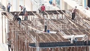 Construction workers lament pay gap, labour laws