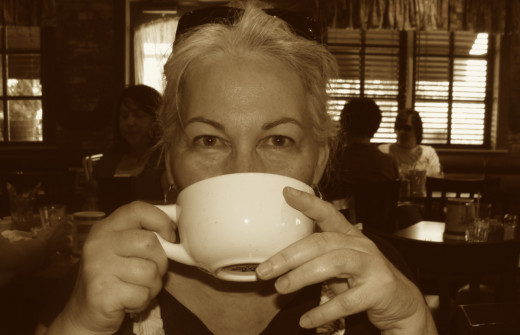 the author enjoying her cup of coffee
