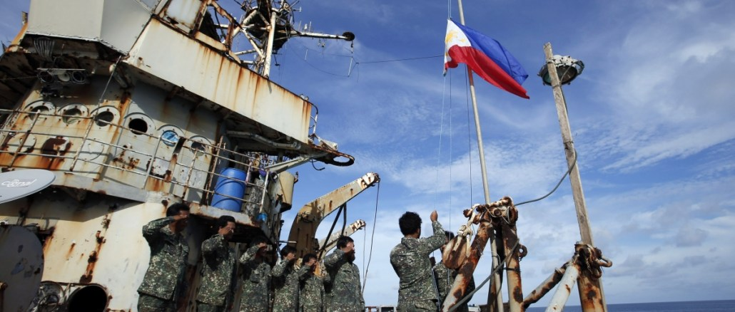 Filipino military personnel saluting at the BRP Sierra Madre outpost located in the disputed Second Thomas Shoal, part of the Spratly Islands in the South China Sea | Image: Reuters