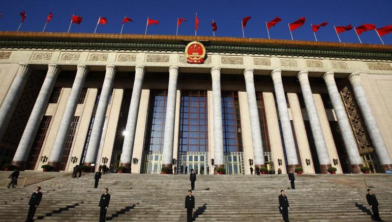 Security officers guard the Great Hall of the People in the midst of the third plenary session of the National People's Congress in Beijing, China on 10 March 2013 I Image: Reuters/Petar Kujundzic