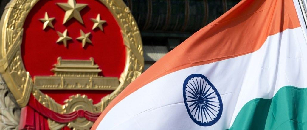 A Chinese emblem and an Indian flag at the Great Hall of the People in Beijing   Source: South China Morning Post