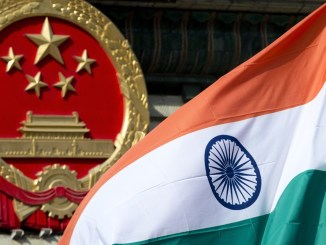 A Chinese emblem and an Indian flag at the Great Hall of the People in Beijing | Source: South China Morning Post