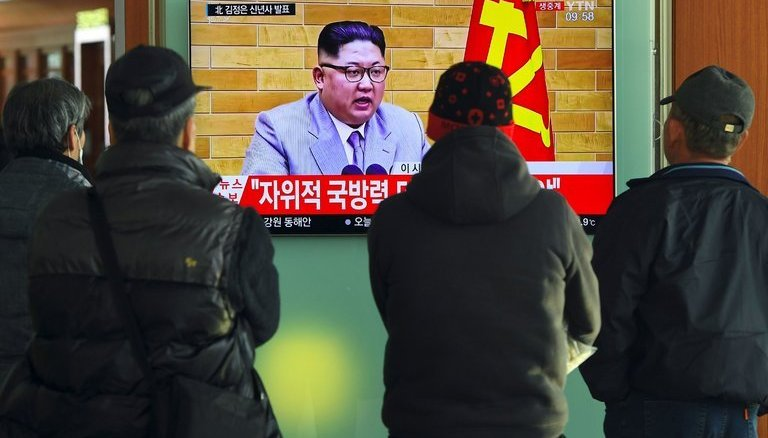 South Koreans at a railway station in Seoul watching a broadcast of North Korea's leader, Kim Jong-un | Photo Source: The New York Times