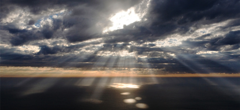 Rays of light break through the clouds.