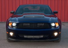 Front Raxiom Black Projector Headlights Turned On