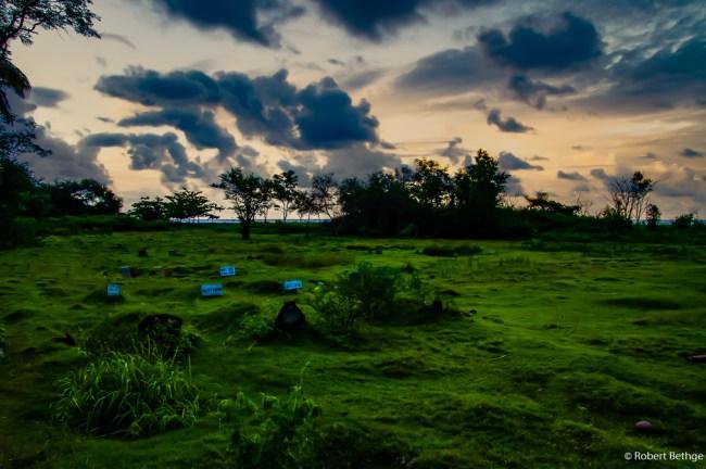 wild graveyard near black sand beach on Bali