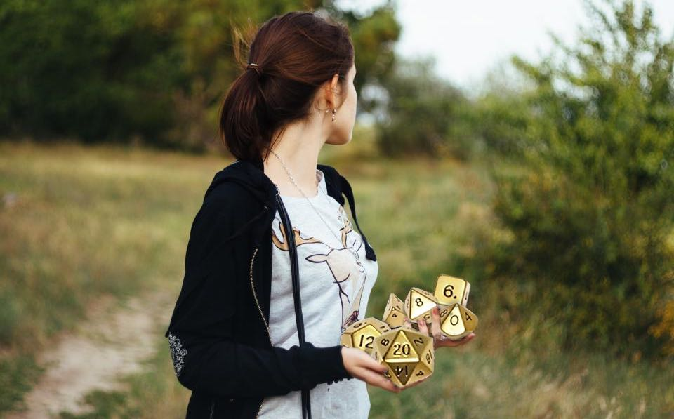 Girl holding golden dice.