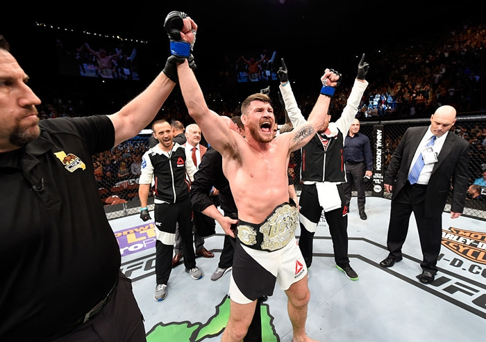 INGLEWOOD, CA - JUNE 04: Michael Bisping of England celebrates after his first round knockout win against Luke Rockhold in their UFC middleweight championship bout during the UFC 199 event at The Forum on June 4, 2016 in Inglewood, California. (Photo by Josh Hedges/Zuffa LLC/Zuffa LLC via Getty Images)