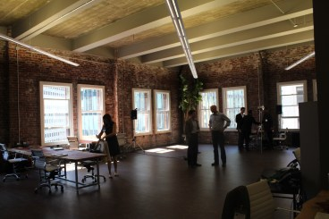 Greenstart officials prepare the incubator space for Mayor Ed Lee's arrival.