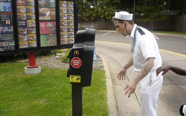 A zombie places an order at McDonald's. For BRAAAAIIIINS.