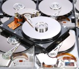 Pile of hard drives with their covers removed