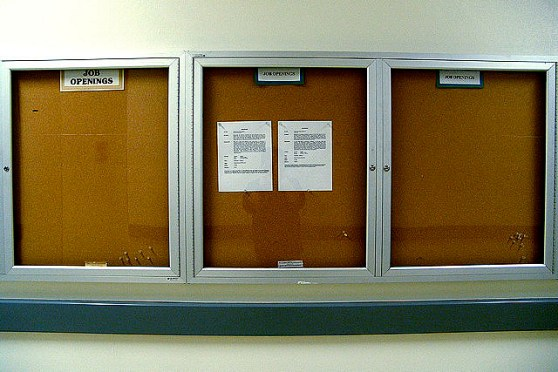 An empty bulletin board represents jobs that aren't there