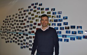Practice Fusion's CEO Ryan Howard surrounded by photos of the staff.