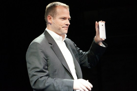 HTC president Jason Mackenzie holding an HTC One