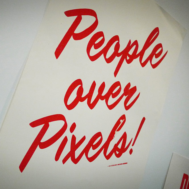 People over Pixels! A sign on display at Facebook headquarters.