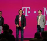 CEO John Legere alongside two other T-Mobile executives.