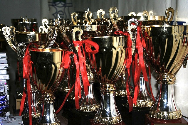 A bunch of trophies on a table