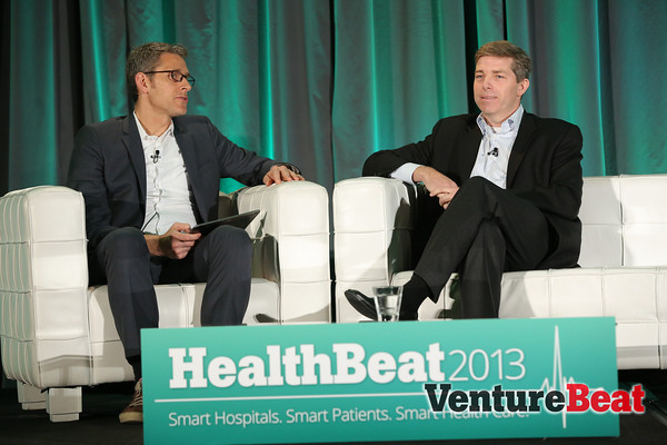 Premier Inc. vice president Sean Cassidy onstage at HealthBeat 2013, with Venturebeat's Matt Marshall