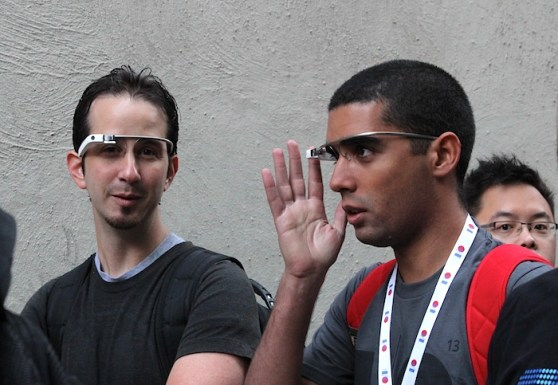 Two guys wearing Google Glass while waiting in line at Google I/O 2013